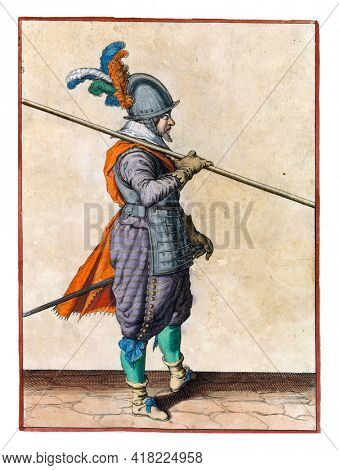 A soldier, full-length, to the right, carrying a spear (lance) on his right shoulder, the point pointed obliquely towards the ground. His right hand on the skewer