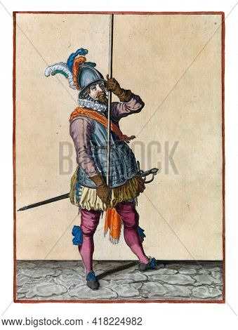 A soldier, full-length, to the right, holding a spear (lance) with both hands upright in front of him high above the ground. This is the first operation to bring the skewer upright to the ground