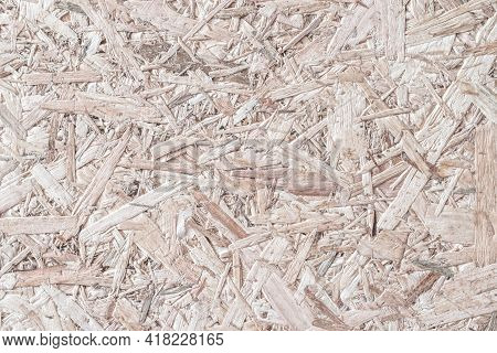 Chipboard, Osb -oriented Strand Board Particle Pressed Recycled Wood Panel Background With Grainy Wo