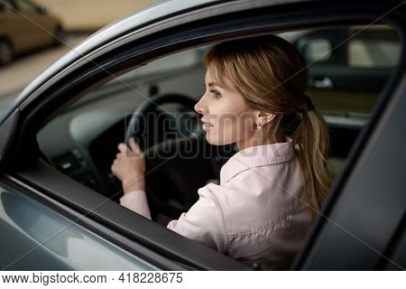 Happy Female Driver Driving A New Car.new Driver In Town