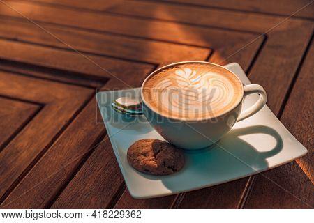 Nice Texture Of Latte Art On Hot Latte Coffee . Milk Foam In Heart Shape Leaf Tree On Top Of Latte A