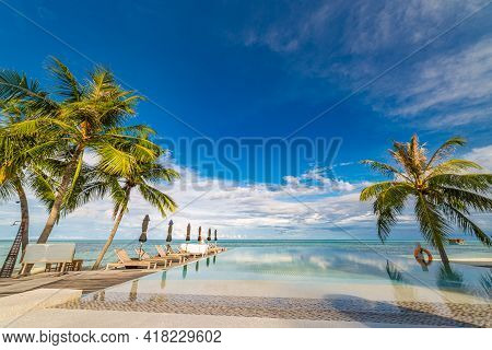Outdoor Tourism Landscape. Luxurious Beach Resort With Swimming Pool And Beach Chairs Or Loungers Um