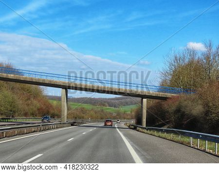 Road A1 From Luxembourg To Trier. A Bridge Spanning Over Dual Carriage Motorway. Sunny Spring Day, L