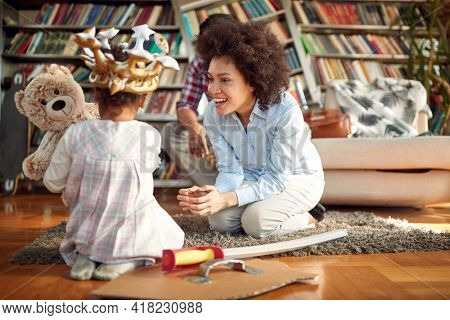 A young Mom enjoys playing with her little daughter in a relaxed atmosphere at home. Family, together, love, playtime