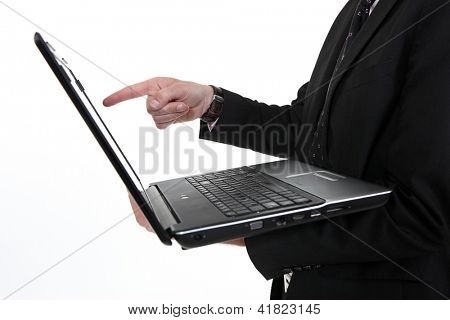 Man pointing at laptop screen