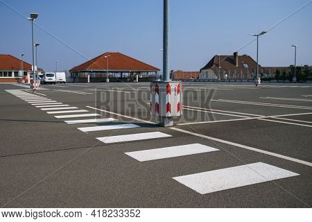 Pedestrian Zebra Crossing In An Empty Parking Lot On The Roof Of A Supermarket. Clear Sunny Day.