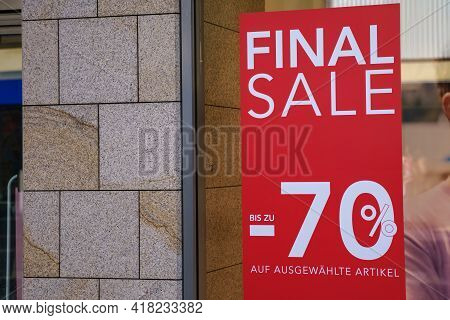 Red Sale Sign On A Window Of A Shop, Announcing A Final Sale Of Up To 70% On All Products. Close Up.