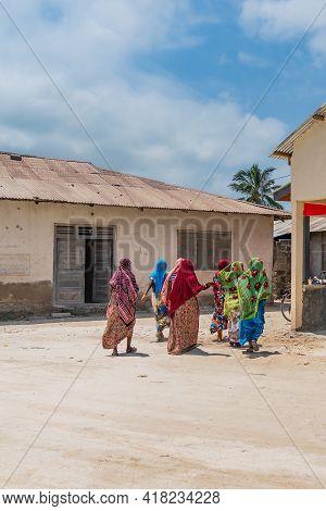 Zanzibar, Tanzania - February 8. 2020: A Group Of Covert Moslem Women At The Street In The Fishing V