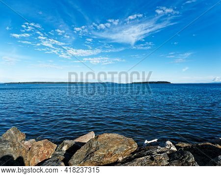 Spectacular Rocky Shore Of Sidney Bc With Beautiful Skies