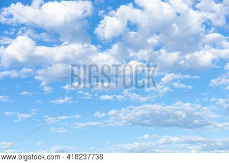 Clear Day With White Cumulus Clouds On A Sunny Day