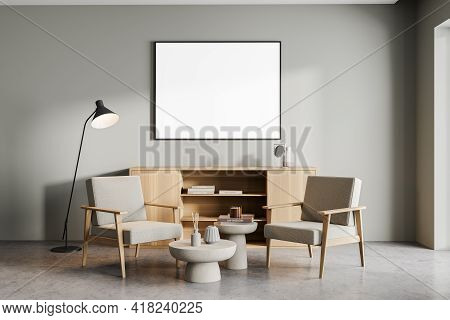 Living Room Interior With Two Vintage Armchairs And Coffee Table, Lamp And Wooden Drawer With Decora