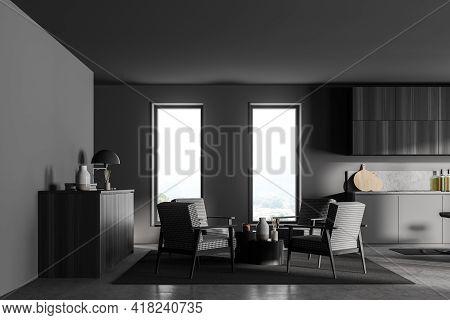 Stylish Interior Of Dark Grey Modern Kitchen Room. Armchairs Livingroom Zone Open Space. 3d Renderin