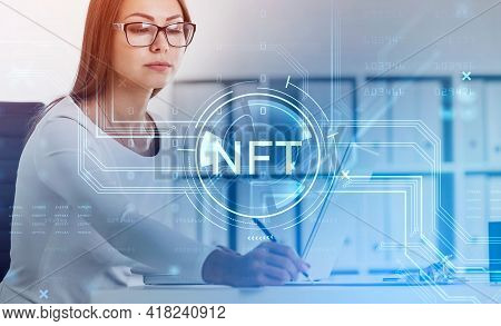 Attractive Businesswoman Working On Laptop And Taking Notes, Non-fungible Token Hologram, Nft With N