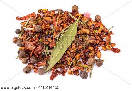 A Mixture Of Crushed Red Cayenne Pepper, Dried Chili Flakes, Rosemary, Peppercorns And Bay Leaf Isol