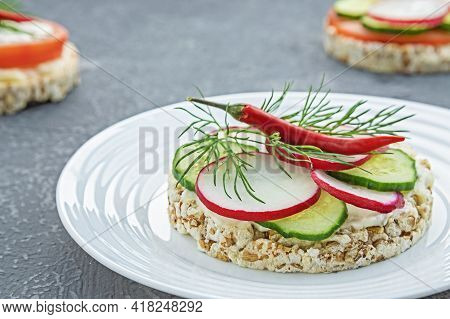 Sandwich Of Diet Bread With Slices Of Radish Cucumber Red Pepper And Melted Cheese In Plate On Concr