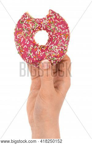 Donut Close-up In Hand On A White Background. Bitten Donut Isolated On White Background.