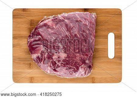 Vacuum Packed Meat On A White Background. Beef In A Vacuum Bag On A Board Close-up.