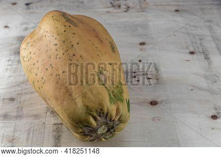 Formosa Variety Papaya Fruit On Wooden Background. Papaya Formosa. Fruit Source Rich In Nutrients. E
