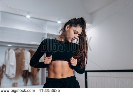 Young Woman With Beautiful Slim Healthy Body Posing.