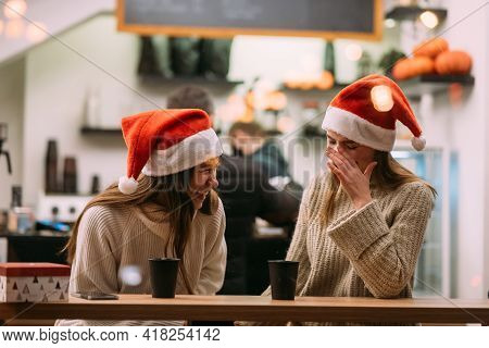 Portrait Of Happy Cute Young Friends Having Fun In Cafe