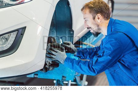 Auto mechanic servicing car in the workshop