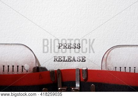 Press release text written with a typewriter.