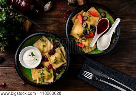 Homemade Dumplings, Vareniki With Blueberry Fillings In Bowl On A Dark Rustic Table With Fresh Berri