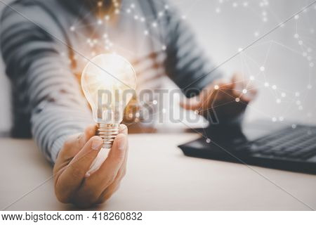 Thinking And Creative Concept, Close Up Light Bulb And Working On The Desk, Creativity And Innovatio