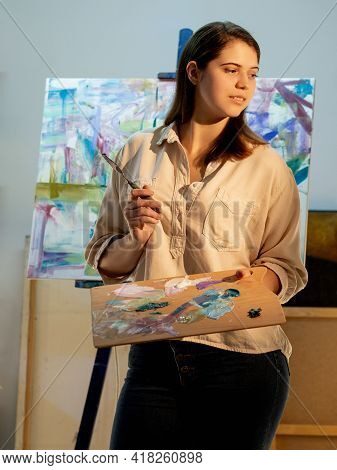 Artistic Woman. Painting Process. Creating Artwork. Fine Art School. Inspiration Muse. Smiling Thoug