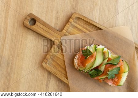 Appetizing Bruschetta Sandwich Made From Whole Grain Bread, With Red Fish And Curd Cheese, With Thin