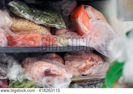 Frozen Foods, Frozen Vegetables And Meats In The Freezer,