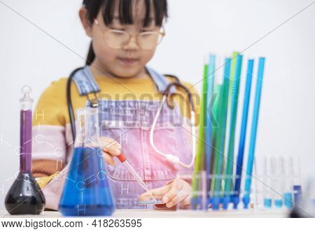 Education And Science Concept, Little Asian Student Girl Making Science Experiment In The Laboratory