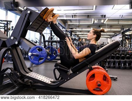 Athlete Performs Leg Exercise. Athletic Woman In The Sportswear Doing A Fitness Workout Training In