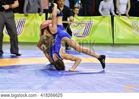 Orenburg, Russia - March 15-16, 2017: Boys Compete In Sports Wrestling