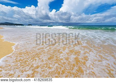 Amazing Beautiful Sandy Beach With Wave Seafoam Clashing On Sandy Shore Turquoise Ocean Water And Bl