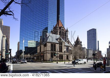 Boston, Ma - April 8 2021: Reflection Of Trinity Church In A Glass Office Building In The Center Of