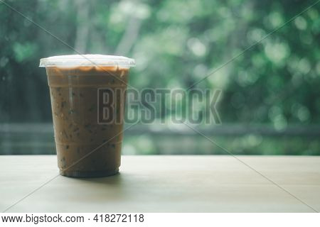Cold Mocha Coffee Drink With Ice On Wooden Table Selective Focus And Copy Space