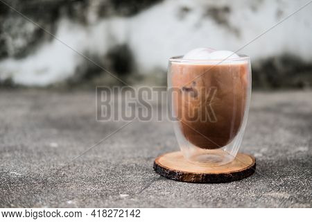 Iced Mocha Coffee In Double Wall Glass On A Dirty Background