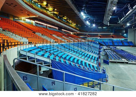 MOSCOW - DEC 18: Empty sport hall with rows of armchairs after concert  Legends of Retro FM in SC Olimpiyskiy, Dec 18, 2011, Moscow, Russia. Festival attracts tens of thousands of spectators.