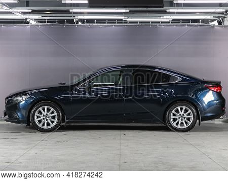 Novosibirsk, Russia - April 25 2021: Blue Sedan Mazda 6 , Side View. Photography Of A Modern Car On