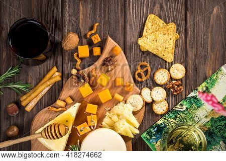 Ingredients For Cooking And Cast Iron Skillet On An Old Wooden Table. Food Background Concept With C