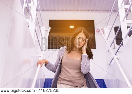 Woman Suffering From Sea Sickness Having Motion Sickness And Feeling Headache While On Boat
