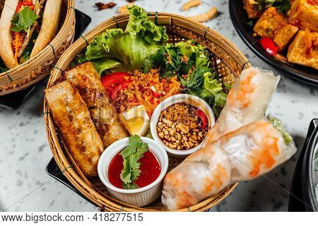 A Closeup Shot Of Delicious Vietnamese Food Including Pho Ga, Noodles, Spring Rolls On White Backgro