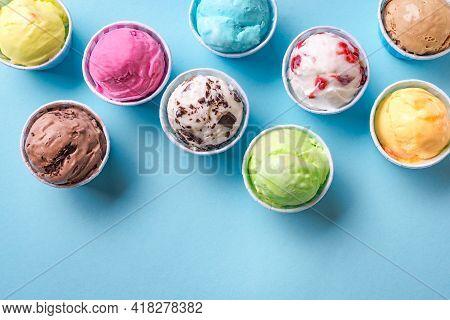 Ice Cream Assortment. Various Ice Creams Or Gelato On Blue Background, Copy Space. Frozen Yogurt  In