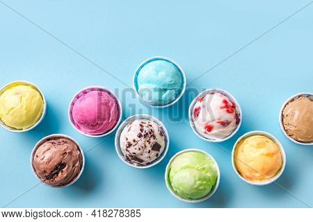 Ice Cream Assortment. Various Ice Creams Or Italian Gelato On Blue Background, Copy Space. Frozen Yo