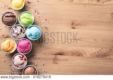 Ice Cream Assortment. Various Ice Creams Or Italian Gelato On Wooden Background, Top View, Copy Spac