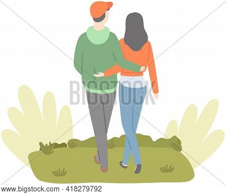 Happy Couple In Love Walking In Park. Tall Guy Spends Time With Pretty Girl Outdoors. Outdoor Activi