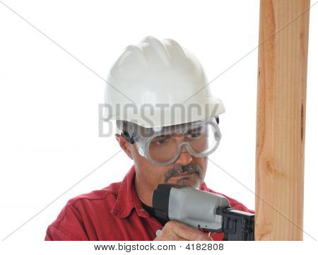 Construction Worker Using Nail Gun