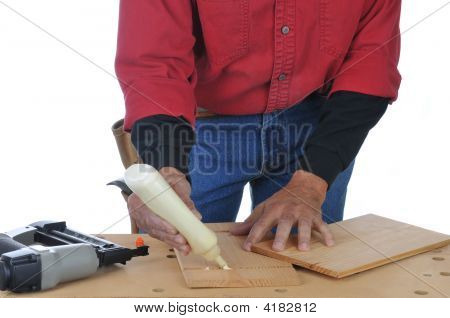 Woodworker Applying Glue