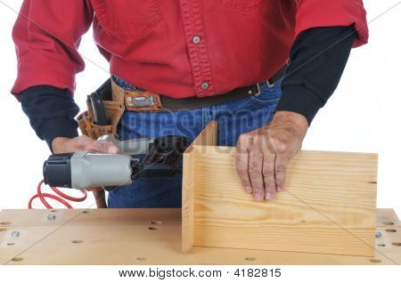 Woodworker Using Nail Gun